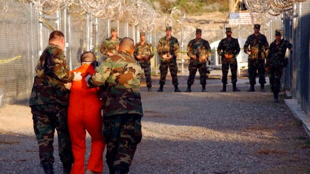 A new report alleges that doctors and psychologists working at Camp X-Ray