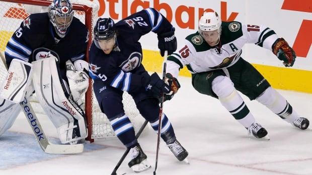 Minnesota Wild's Dany Heatley chases down Winnipeg Jets' Zach Redmond during a game in Winnipeg in September.