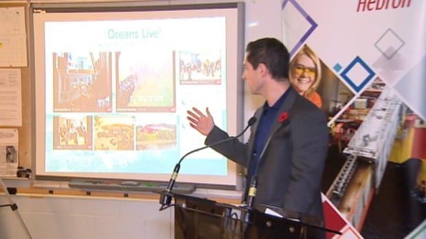 Adam Rowe, who works with the Oceans Learning Partnership, demonstrates the Digital Oceans Project at Holy Spirit High School.