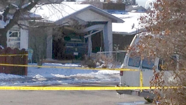 A man drove a pickup truck into an Albert Park house this morning after being shot by a Calgary police officer.