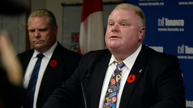 Toronto Mayor Rob Ford, right, speaks to the media at Toronto City Hall Tuesday. Ford admitted that he has smoked crack cocaine, probably 'in one of my drunken stupors,' but insisted he's not an addict.