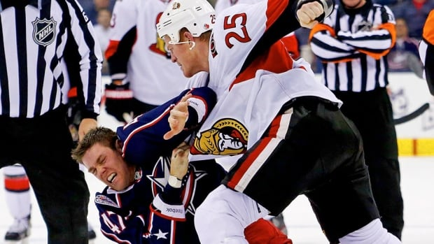 Senators tough guy Chris Neil, right, seen here fighting Dalton Prout of the Blue Jackets on Tuesday, believes there would be more illegal stick work if the NHL banned fighting.