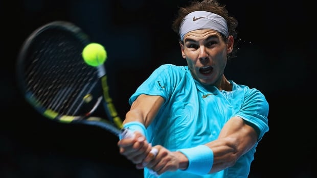 Rafael Nadal hits a backhand during his men's singles match against Stanislas Wawrinka at the ATP finals. Nadal won 7-6 (5), 7-6 (6) to clinch the No. 1 ranking for a third time.