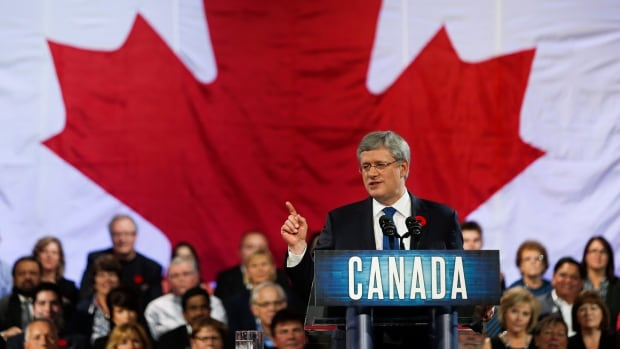 Prime Minister Stephen Harper speaks to party faithful at the Conservative convention in Calgary last week. Abroad, the tone is more hectoring, former prime minister Joe Clark says.