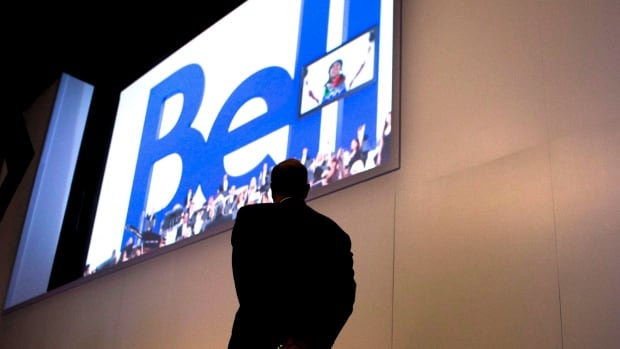BCE CEO George Cope watches a presentation as he attends the company's AGM in Toronto on May 9, 2013. BCE Inc. is reporting profit fell to $343 million in the third quarter.
