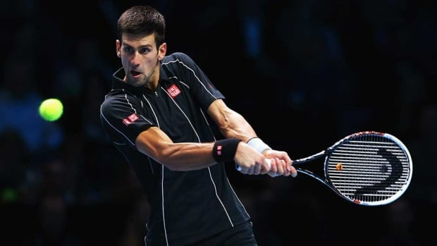 Novak Djokovic hits a backhand in his men's singles match against Juan Martin Del Potro at the ATP World Tour Finals at O2 Arena on Thursday in London.