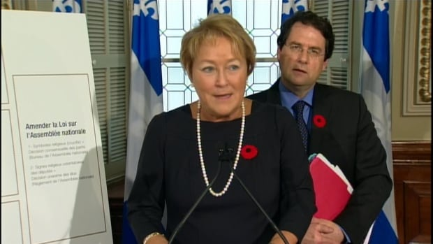 Quebec Premier Pauline Marois and minister in charge of the secular charter Bernard Drainville table Bill 60 at the national assembly this fall.