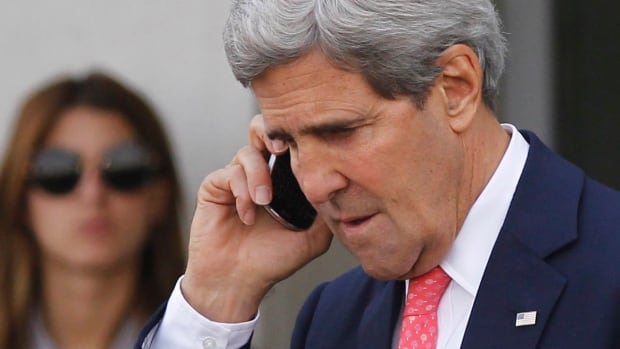 "U.S. Secretary of State John Kerry speaks on a mobile phone after meeting with Israeli Prime Minister Benjamin Netanyahu in Tel Aviv Friday. Netanyahu said he ""utterly rejects"" the emerging nuclear deal between western powers and Iran, calling it ""very, very bad"" and promising that Israel will do everything it needs to do to defend itself."