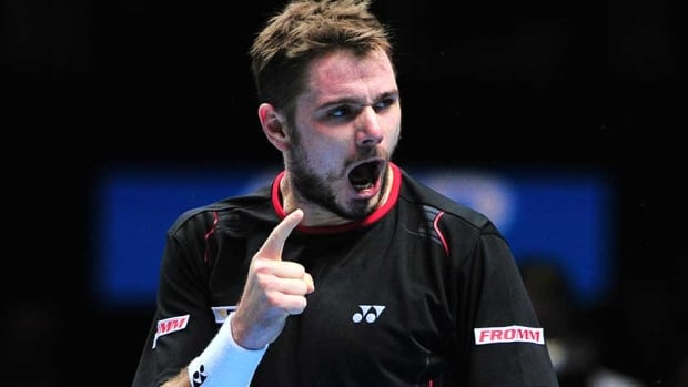 Stanislas Wawrinka celebrates winning a game on the way to beating Spain's David Ferrer  in the round robin stage on the fifth day of the ATP World Tour Finals in London on Friday.