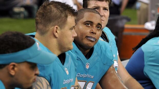 Miami Dolphins guard Richie Incognito (68), and  and tackle Jonathan Martin (71) have been the centre of some unwanted attention over the past week.