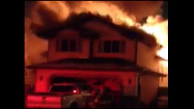 A massive fire tore through a St. Albert home Friday night.