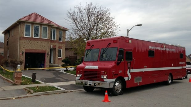 Emergency crew in Brampton attend to the scene of a deadly fire Saturday morning. One 45-year-old woman succumbed to her injures in hospital.
