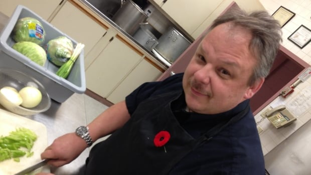 Branch president Rob Stejskal helps out in the kitchen at the Slovak Legion in Thunder Bay's east end. Stejskal says he hopes more people will join the legion for the camaraderie and the history.