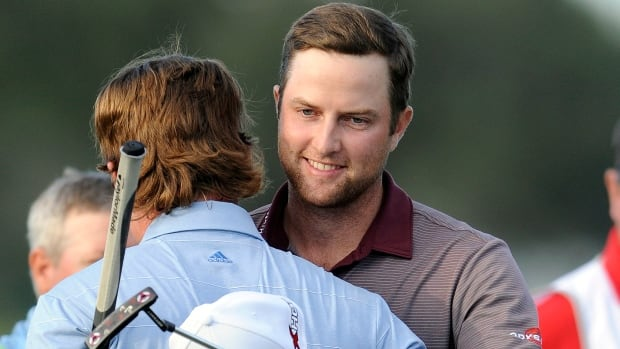 Chris Kirk, right, hugs Briny Baird after winning the McGladrey Classic on Sunday in St. Simons Island, Ga.