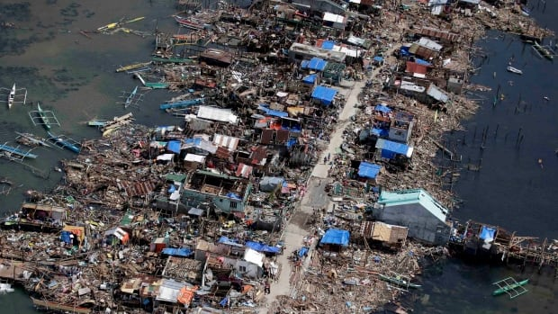An aerial image taken from a Philippine Air Force helicopter shows the devastation of the first landfall by typhoon Haiyan in Guiuan, Eastern Samar province, central Philippines Monday, Nov. 11, 2013. Authorities said at least 2 million people in 41 provinces had been affected by Friday's typhoon Haiyan and at least 23,000 houses had been damaged or destroyed.