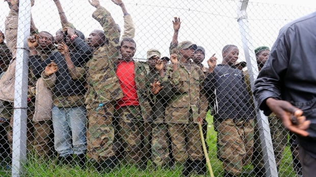 Some of the M23 fighters who surrendered to Uganda's government are seen inside an enclosure at Rugwerero village, about 500 km west from Uganda's capital, Kampala. Congo has accused Uganda of backing the rebels and undermining peace negotiations.