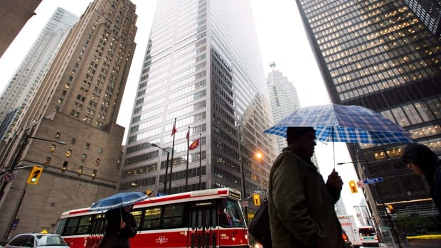 Toronto's financial district is home to some of Canada's largest banks. Barclays has downgraded stock in four of them.