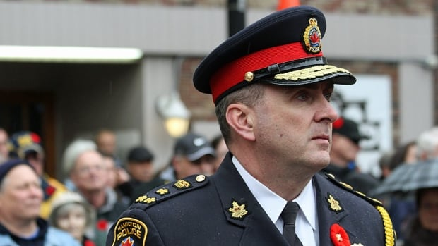 "Hamilton Police Chief Glenn De Caire, shown at this month's Remembrance Day ceremony, says the city is below the provincial median in clearing violent crime cases. ""(It's) not as high as we would like it to be."""