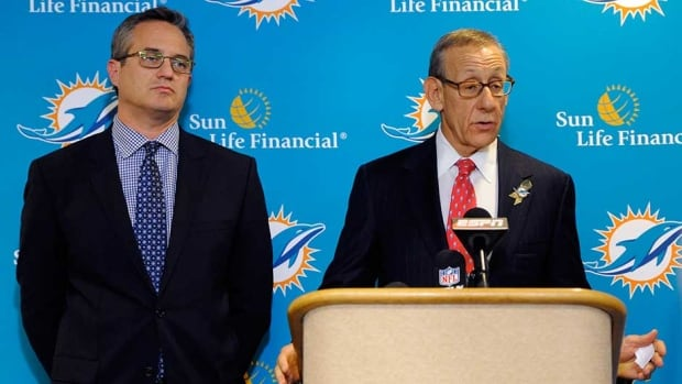 Miami Dolphins owner Stephen Ross, right, and CEO Tom Garfinkel address the media before the team's game against the Tampa Bay Buccaneers on Monday in Tampa, Fla.