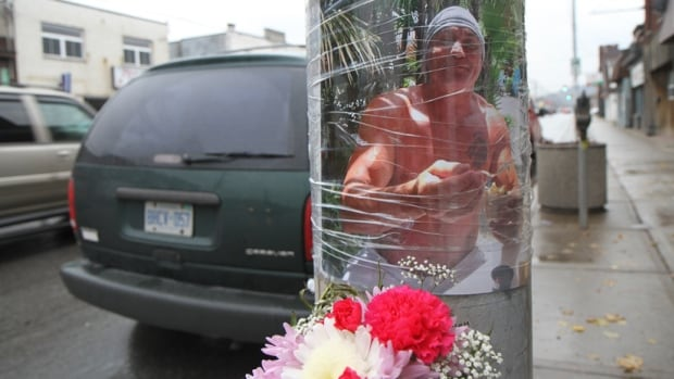 "Pictures, flowers and messages adorn a lamppost on Kenilworth Avenue North on Monday, located just steps away from where James ""Lou"" Malone was killed over Nov. 9."