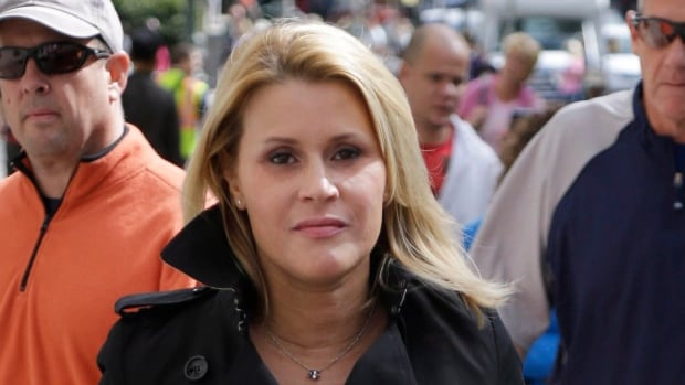 Canadian actress Genevieve Sabourin, shown leaving a New York court in July, is accused of stalking actor Alec Baldwin. Baldwin and Sabourin met on the set of the 2002 sci-fi comedy The Adventures of Pluto Nash, in which he had a cameo and she was a publicist. Her trial opened Thursday in Manhattan.