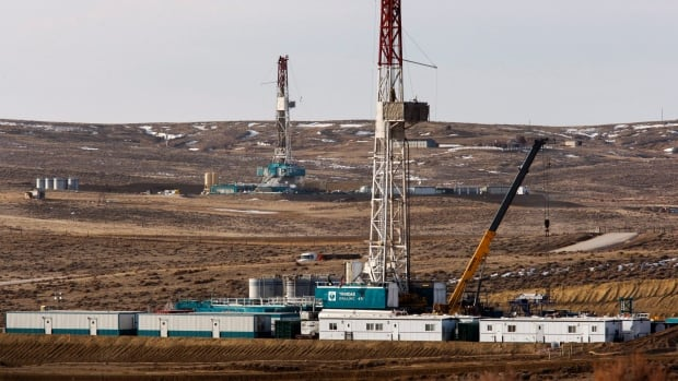Drilling rigs are seen  just outside of Douglas, Wyo. The area has been undergoing an oil boom for the past year, part of a trend the International Energy Agency believes will make the U.S. self-sufficient in energy.