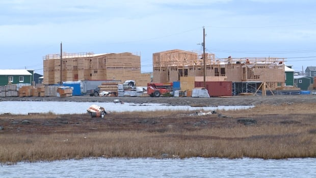 Fifty public housing units being built in Arviat in 2013. Nunavut finance minister Keith Peterson says the territory still needs another 3500 to 4000 new units.