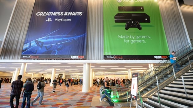 Banners for the Sony PS4 and Xbox One gaming systems hang at the GameStop Expo in Las Vegas in August. The two systems will be commercially available this month.