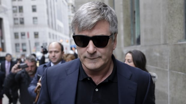 Actor Alec Baldwin leaves criminal court in New York on Tuesday after her testified that he never had a sexual or romantic relationship with Canadian actress Genevieve Sabourin, who is accused of stalking him.