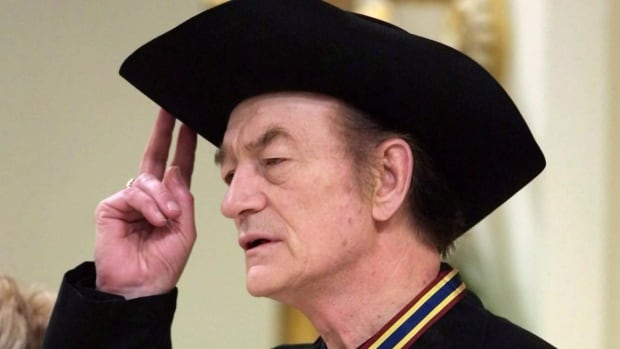 Stompin' Tom Connors holds his hat during the singing of O'Canada following the presentation of the Governor General's Performing Arts Awards during a ceremony at Rideau Hall in Ottawa, Friday, Nov. 3, 2000.