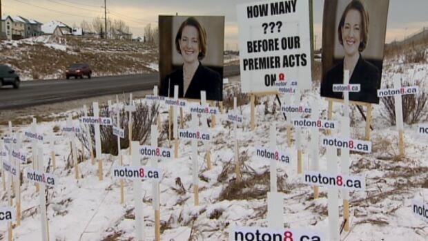 Crosses and signs along Highway 8 are part of a campaign to ban heavy truck traffic on the provincial road.