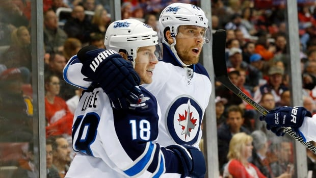 Winnipeg Jets centre Bryan Little (18) celebrates a goal with Blake Wheeler. The players were two of the best for the team in the 2013-14 season.