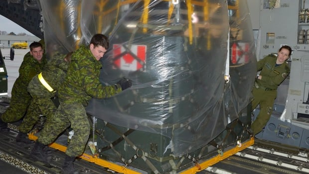 National Defence Minister Rob Nicholson confirmed on Wednesday that Canada's Disaster Assistance Response Team, which was in Hawaii awaiting instructions, is now on its way to Iloilo in the Philippines. Members of the advance team are seen here loading equipment into a C177 Globemaster at Canadian Forces Base Trenton on Monday, November 11, 2013.