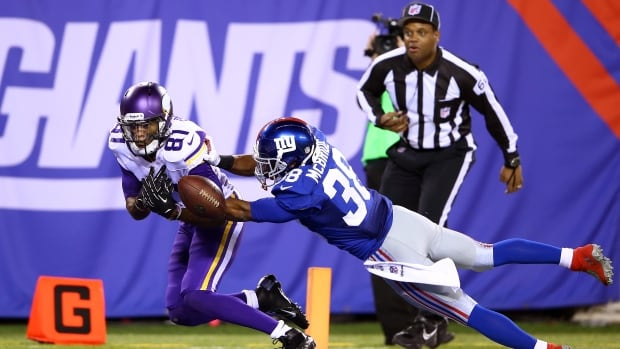Wide receiver Jerome Simpson of the Minnesota Vikings, seen here against Trumaine McBride and the New York Giants in Week 7, is expected to play this weekend against Seattle despite facing drunken-driving charges.