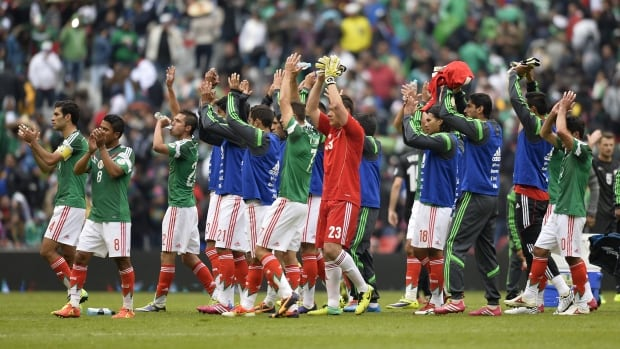 Mexican players celebrate after beating New Zealand 5-1 in their FIFA World Cup intercontinental play-off football match in Mexico City on Wednesday.