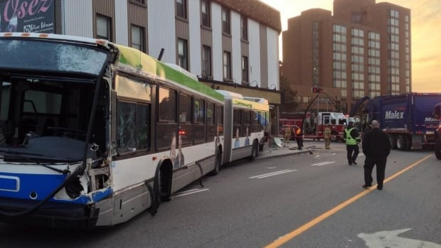 This STO bus, left, crashed with the garbage truck, right, causing extensive damage to the Vice Versa furniture store at Montcalm and Wellington.