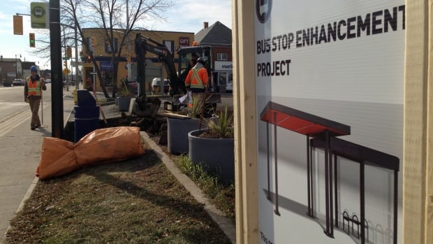 Work crews lay the ground for a new bus shelter at the corner of Bay and Algoma Streets in Thunder Bay.