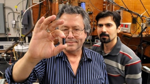 Simon Fraser University physicists Mike Thewalt, left, and Kamyar Saeedi and their research team made qubits from phosphorus atoms embedded in a very pure silicon crystal such as the one held by Thewalt in his lab.