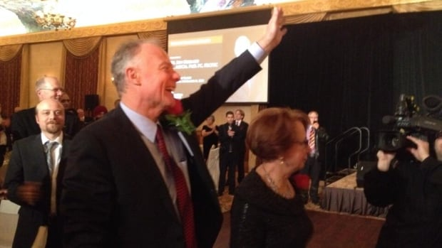 Former Manitoba Liberal leader Jon Gerrard waves to supporters at a party tribute to him Thursday night in Winnipeg.