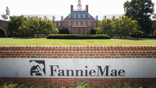 The Fannie Mae headquarters is seen in Washington. As the U.S. housing market recovers, Fannie Mae profits have helped reduce the government deficit. Now private investors want a slice.