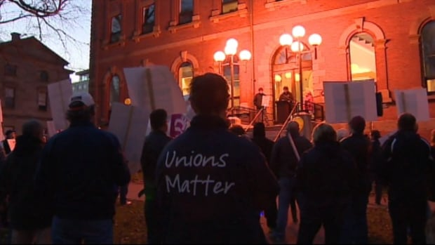 A couple hundred people rally in Charlottetown against changes to public sector pensions.