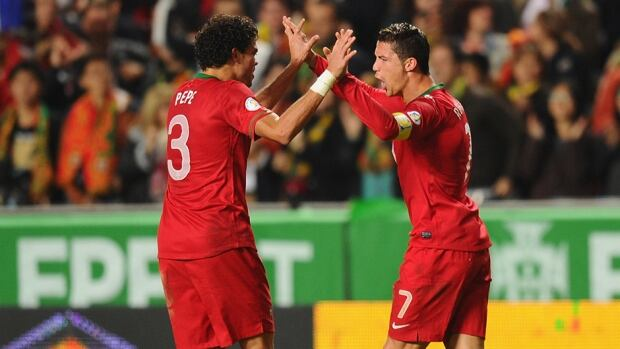 Cristiano Ronaldo of Portugal, right, celebrates after scoring against Sweden at Estadio da Luz on November 15, 2013 in Lisbon, Portugal.