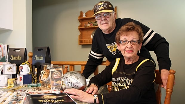 Irene and Walter Teufel, members of the Cats Claws fan club, are helping to organize a bus trip for Hamilton Tiger-Cats fans to Toronto for the team's contest against the Argonauts in the CFL East Division final on Sunday.