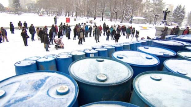 About two dozen people gathered near the steps of the Alberta Legislature Saturday afternoon to protest expanding oilsands operations in the province.