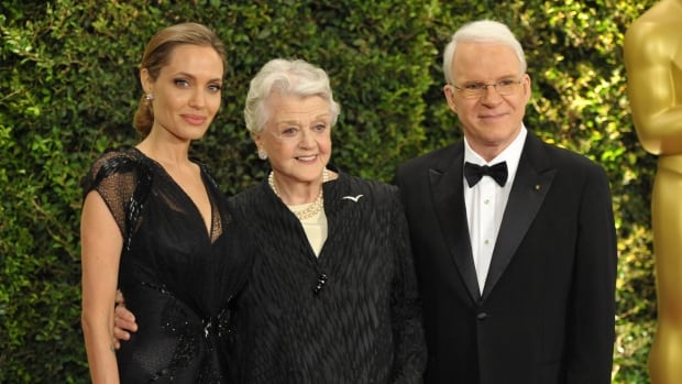 Angelina Jolie, Angela Lansbury and Steve Martin pose on the red carpet at the 2013 Governors Awards on Saturday.