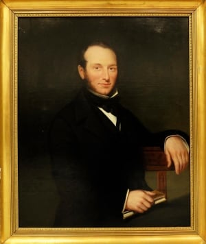 Portrait of Man Holding Book