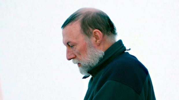Catholic priest Eric Dejaeger leaves an Iqaluit, Nunavut courtroom Jan. 20, 2011 after his first appearance for six child sexual abuse charges in Igloolik dating back to the 1970s.