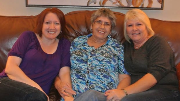 Biological mother Elizabeth Grinham, centre, and her daughter Lisa Braye, right, were reunited in October after 45 years apart. Loretta Grinham Noble, left, is Braye's sister.