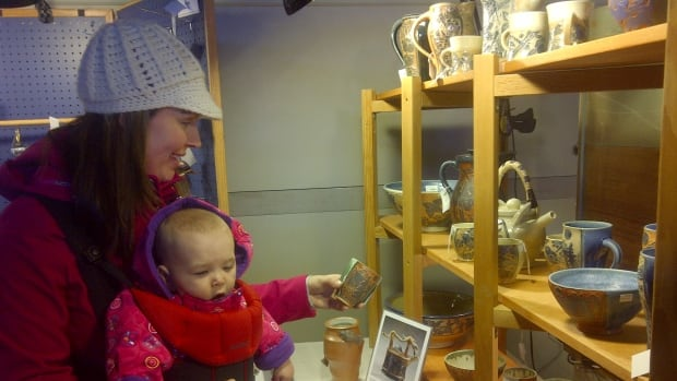 A woman with her child takes in some of the handmade crafts at Bragg Creek's 37th annual Christmas craft market.