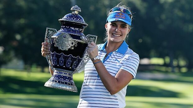 Lexi Thompson of the USA poses with the winner's trophy after her victory at the Lorena Ochoa Invitational on November 17, 2013 in Guadalajara, Mexico.